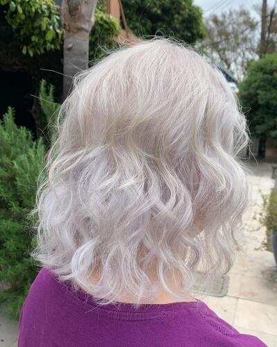 Curly Back Brushed Shoulder-length Hairstyle
