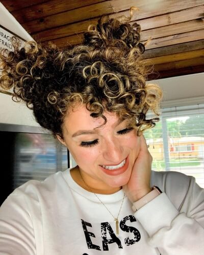 Curly Space Buns and Long Side Bangs Hairstyle