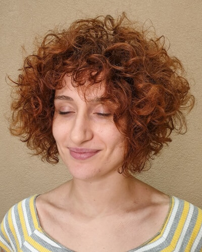 Dimensional Concave Curly Bob with Shaggy Bangs