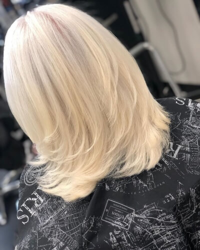 Feathered Low Layers Medium Haircut