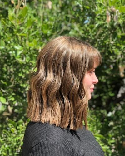 Front Arched Bangs with Wavy Bob and Harsh Blunt Cut