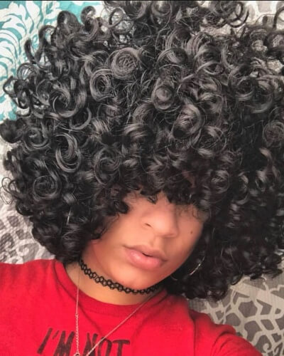 Full Afro and Bangs Hairstyle with Big Curls