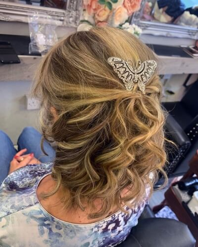 Half Up Statement Clip Hairstyle for Loose Curl Accentuation