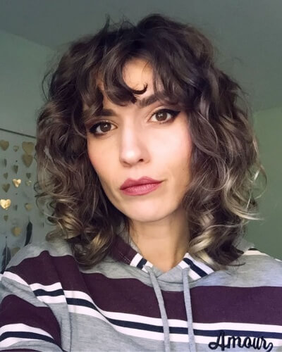 Piecey Curly Shag Cut with Thick Bangs and Lowlights