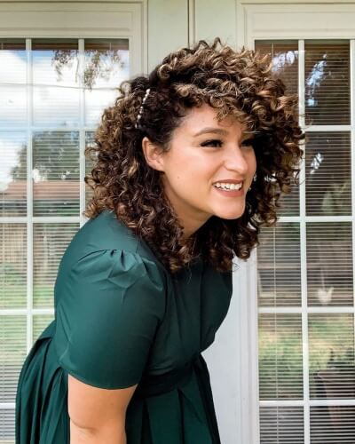 Side Pinned Hairstyle for Shoulder-length Curly Hair and Side Bangs