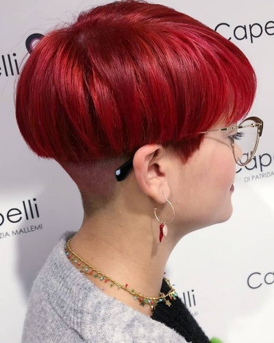 Bowl Cut Hairstyle with Side Swept Bangs and Undercut