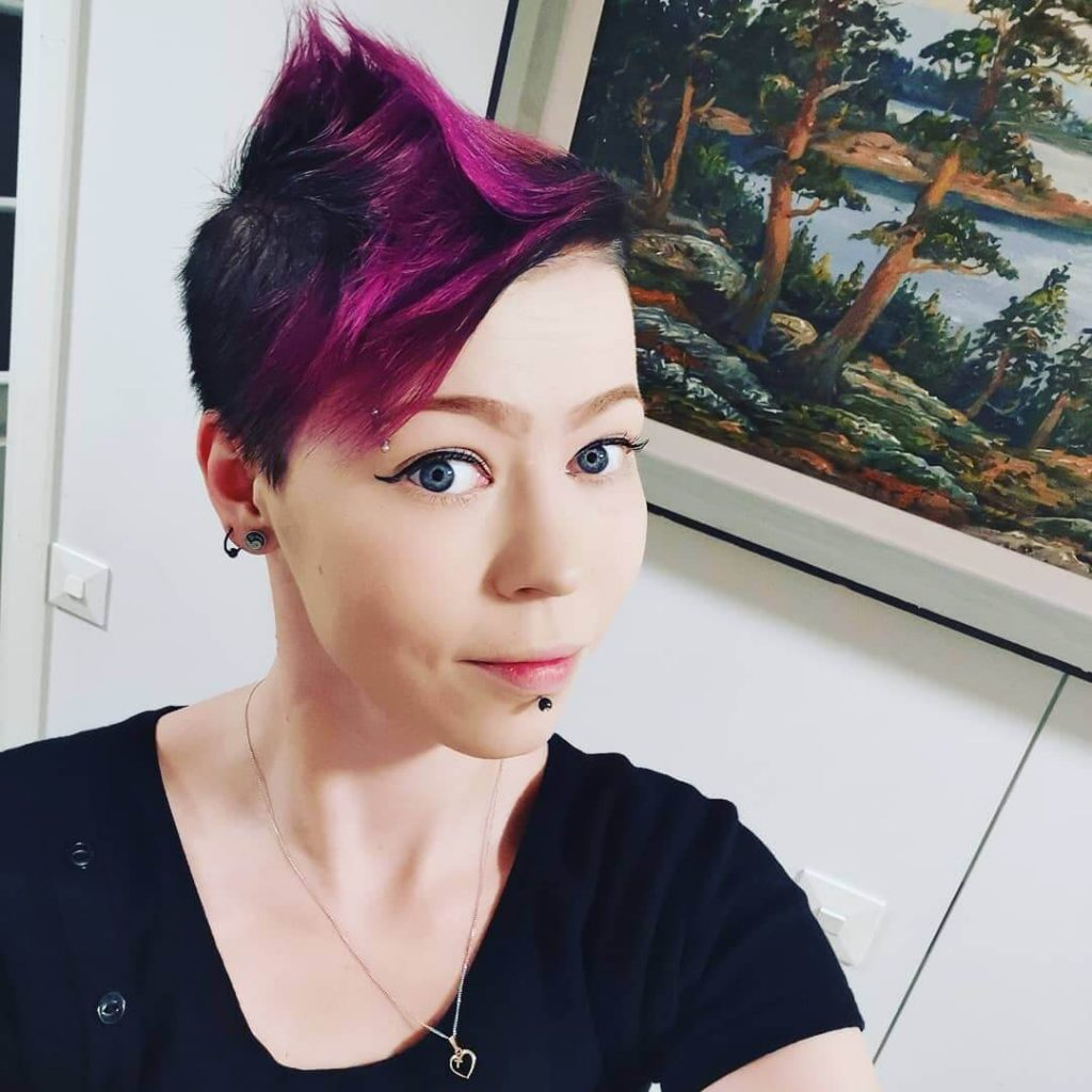 Edgy Mohawk with Side Bangs and Undercut