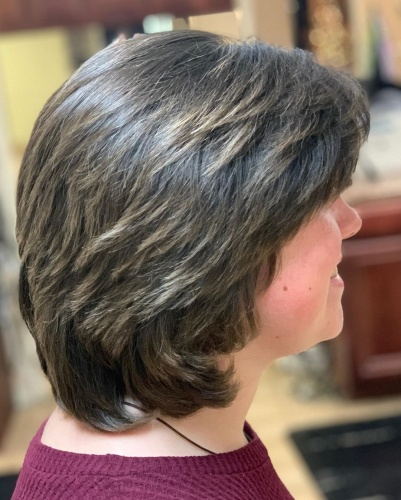 Feathered Layered Bob Haircut with Side Bangs