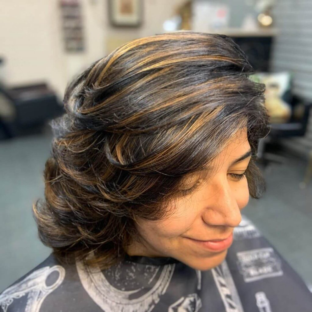 Feathered Medium Bob Hairstyle with Wispy Highlights