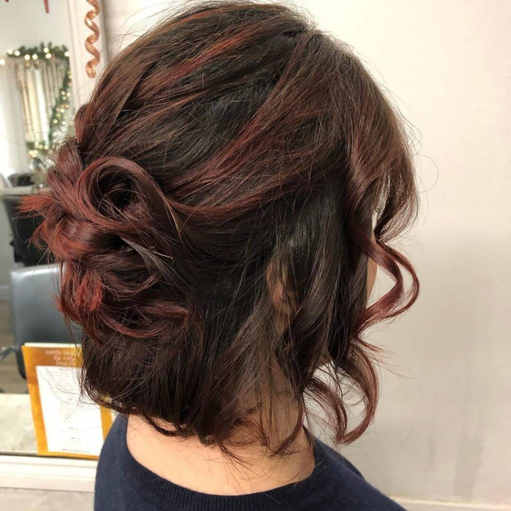 Half Up Messy Hairstyle with Face Framing Bangs for Round Faces