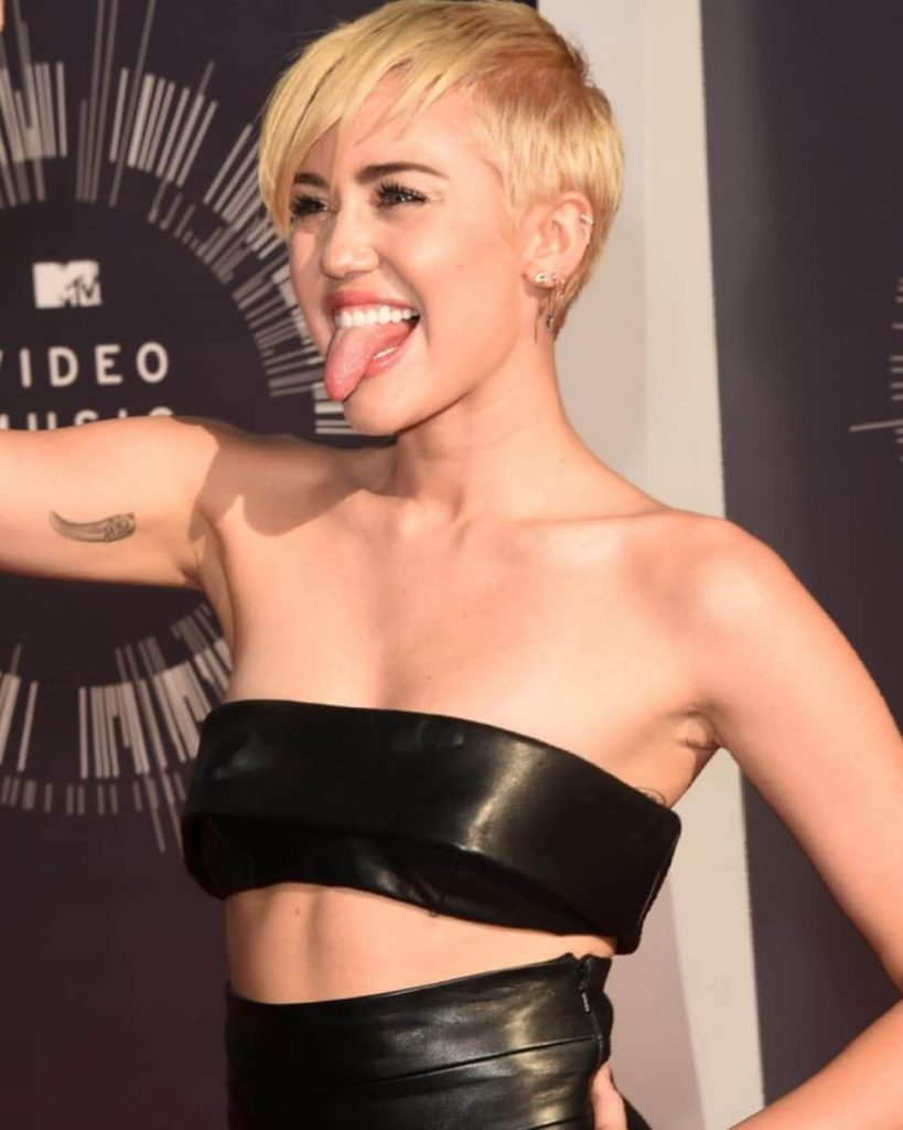 Miley Cyrus Pixie Haircut with Long Side Bangs