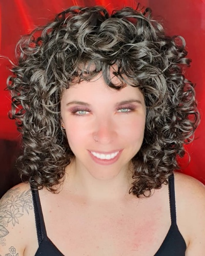 Short Bangs and Messy Shoulder-length Curly Hairstyle
