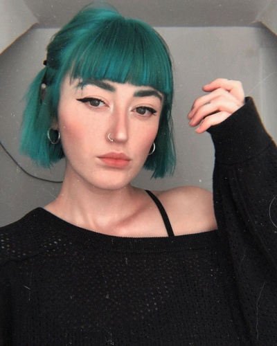 Short Blunt Bob with Blunt Brow Bangs Hairstyle