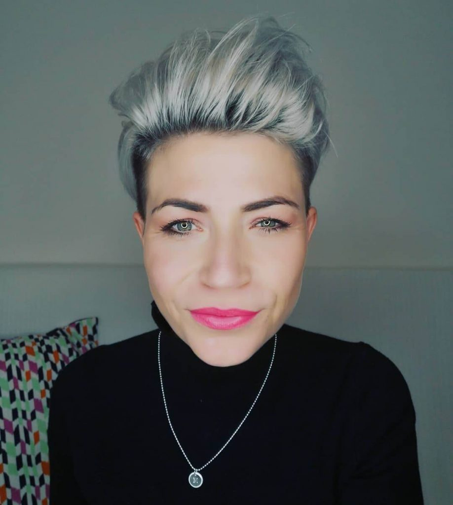 Swept Back Pompadour Pixie Hairstyle with Undercut