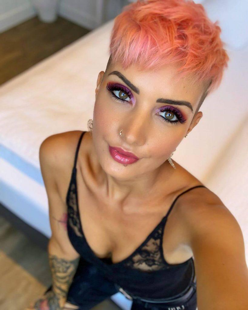 Textured Angular Fringe Pixie Hairstyle with Undercut