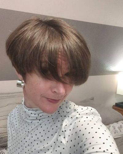 Wedge Cut with Long Side Swept Bangs