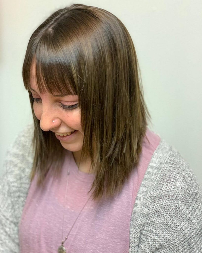 Wispy Curtain Bangs and Shoulder-length Low Layers Haircut