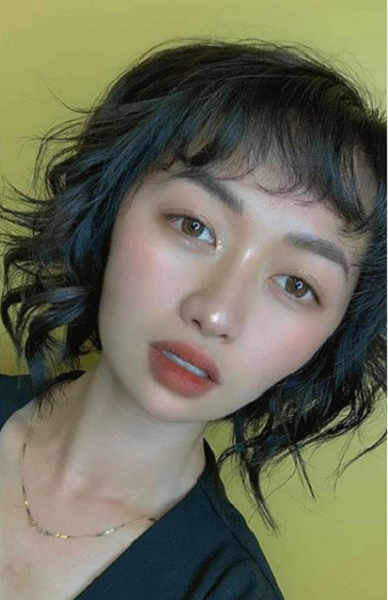 Curly Short hairstyle with Wispy Ends for Asian Women