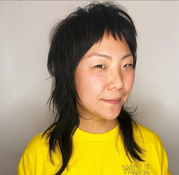 Short Wavy Mullet Hairstyle with Baby Bangs for Asian Women