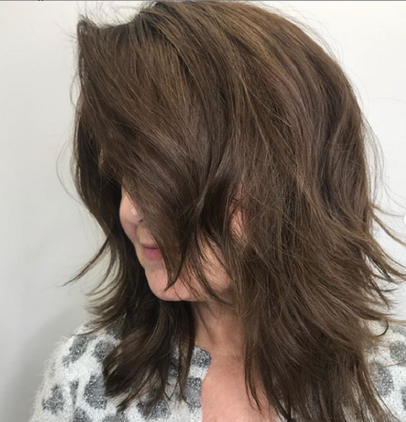 Feathered Medium Haircut with Long Side Bangs