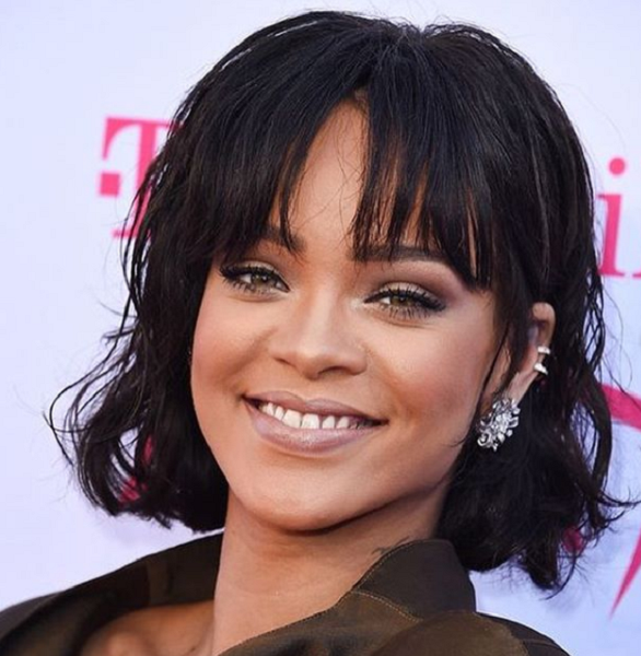 Layered & Wavy Short Hairstyle with Bangs for Black Women