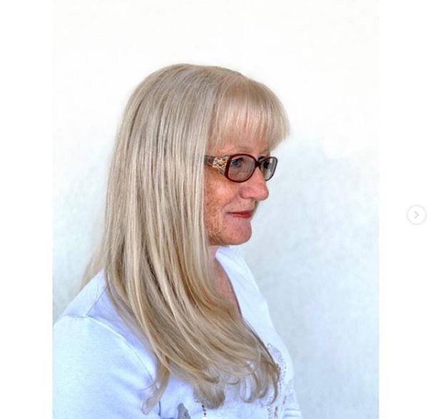 Long Sleek Hairstyle with Blunt Bangs
