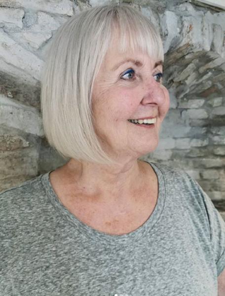 Sleek Bob Hairstyle with Fringe for Older Women