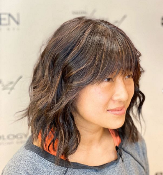 Wavy Short Hairstyle with Feathered Bangs for Diamond Faces