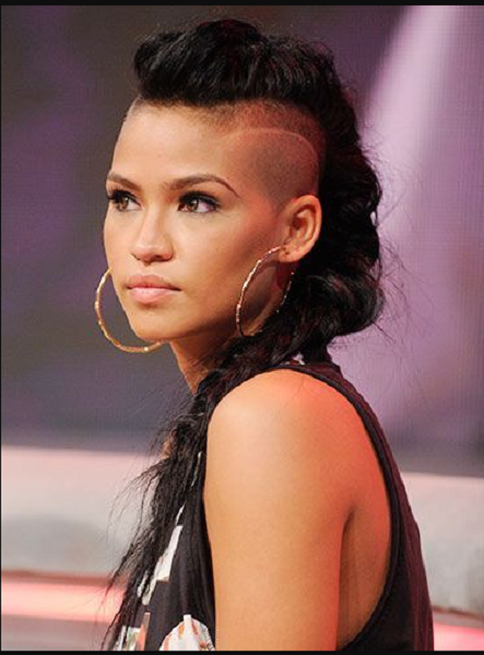Mohawk-Like Hairstyle with Shaved Sides and Braid