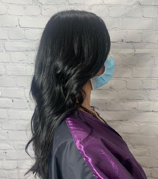Dark Layered Haircut with Long Curtain Bangs