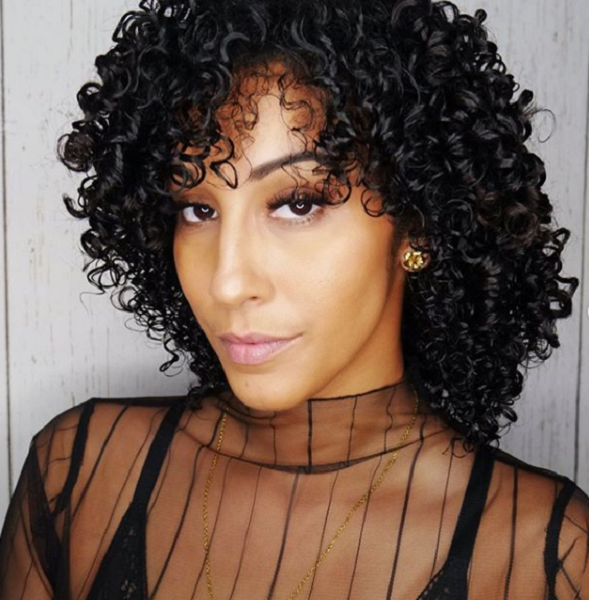 Glossy Medium Curly Hairstyle with Side-Parted Curly Bangs