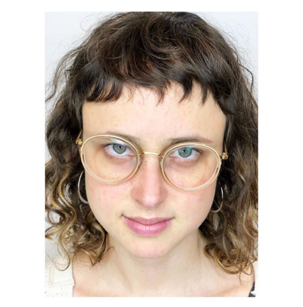 Medium Curly Hairstyle with Razor Cut Baby Bangs