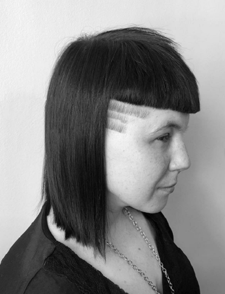 Medium Straight Haircut with Blunt Baby Bangs and Side Shave