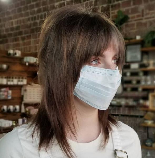Medium Straight Razor Cut Punk Hairstyle with Curtain Bangs