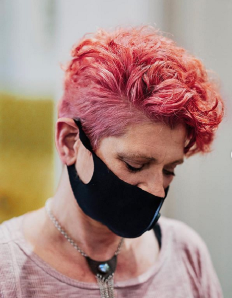 Pink Curly Pixie with Short Sides and Nape Areas