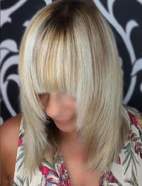 Sleek Haircut Framing Layers Long Bangs