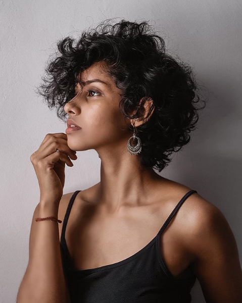Voluminous Side-Parted Curly Pixie