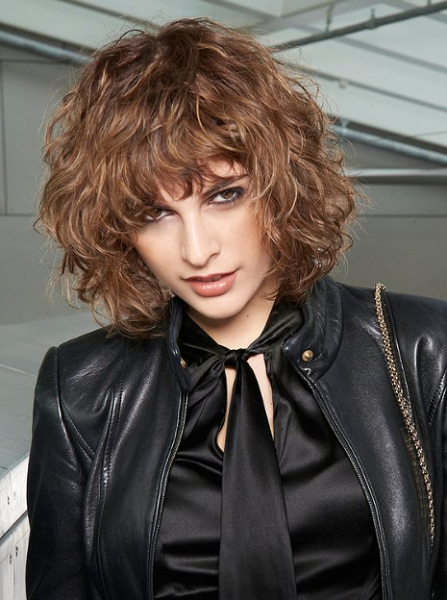 Shag-Like Curly Hairstyle with Blunt Bangs