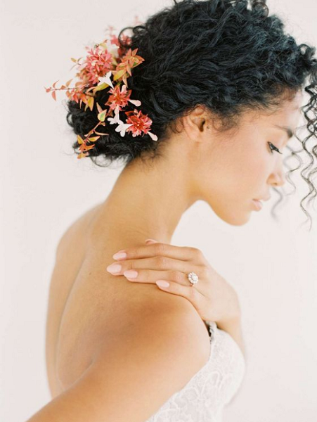 Elegant Messy Low Bun with Curly Hair and Accessories