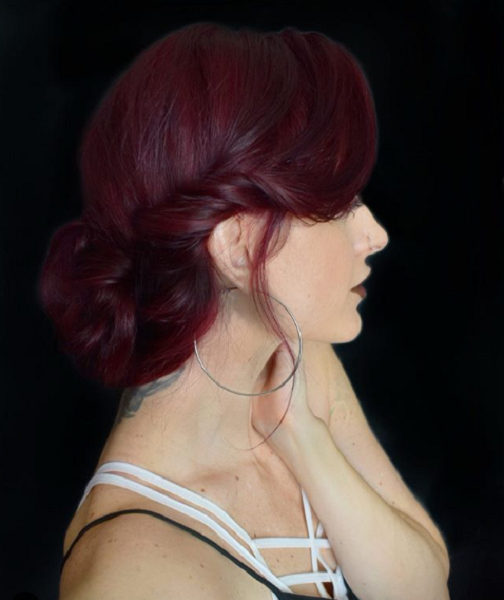 Low Bun with Twisted Side Part
