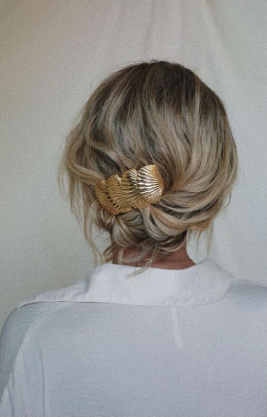 Low Messy Bun with Gold Accessories