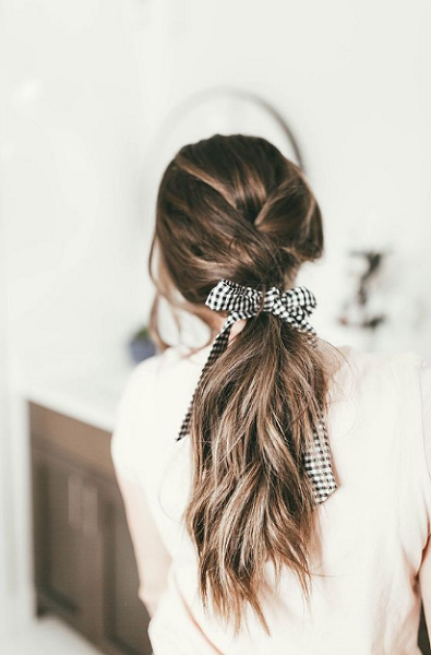 Low Messy Ponytail with Ribbon