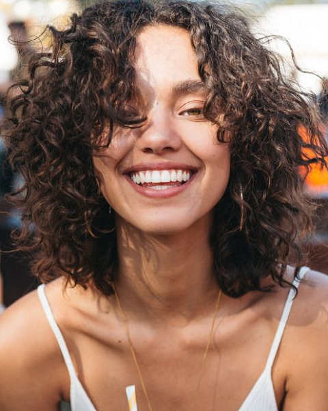 Messy Curly Middle-Parted Hairstyle