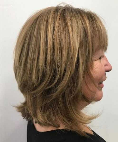 Straight Short Hairstyle with Blunt Bangs and Wispy Ends