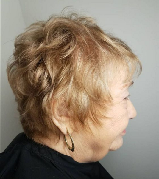 Wavy Short Hairstyle with Long Sides and Bangs