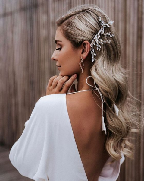 Wavy Side-Parted Bridal Hairstyle with Bejeweled Accessory