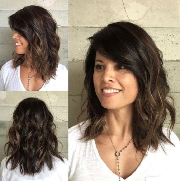 Wavy Side-Parted Medium-Length Layered Hairstyle
