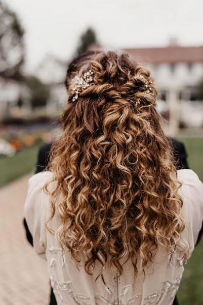 Curly Half Up Half Down Hairstyle with Twisted Crown and Accessories