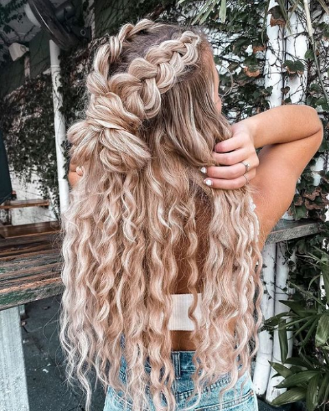 Long and Wavy Half Up Half Down Hairstyle with Thick Braids and Massive Knotted Bun