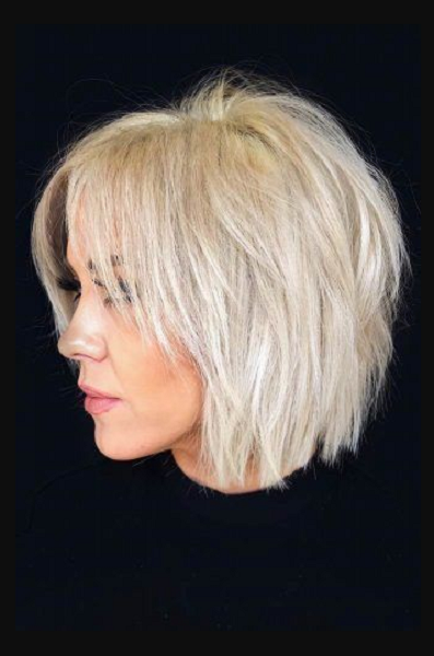 Messy Middle-Parted Feathered Short Hairstyle